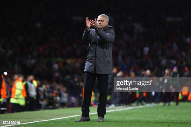 Jose Mourinho manager of Manchester United applauds the Anderlecht fans after the UEFA Europa League quarter final second leg match between...