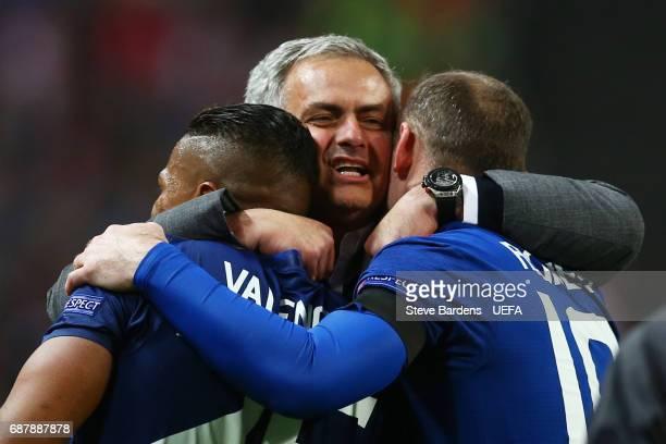 Jose Mourinho Manager of Manchester United celebrates with Wayne Rooney and Antonio Valencia of Manchester United following victory in the UEFA...