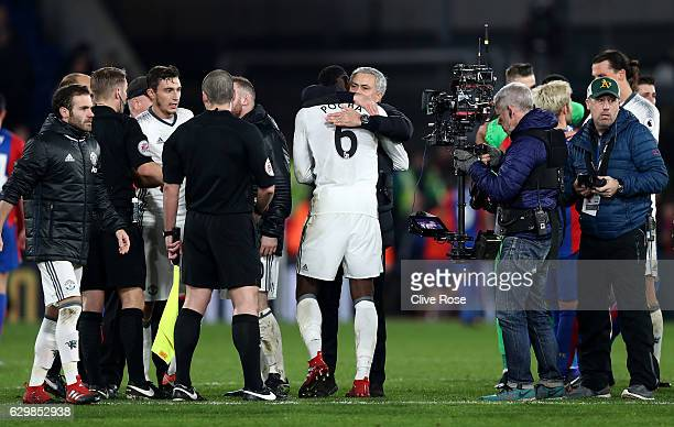 Jose Mourinho Manager of Manchester United congratulates Paul Pogba after the Premier League match between Crystal Palace and Manchester United at...