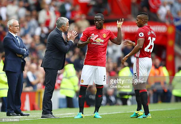 Jose Mourinho Manager of Manchester United gives Eric Bailly of Manchester United and Antonio Valencia of Manchester United instructions during the...