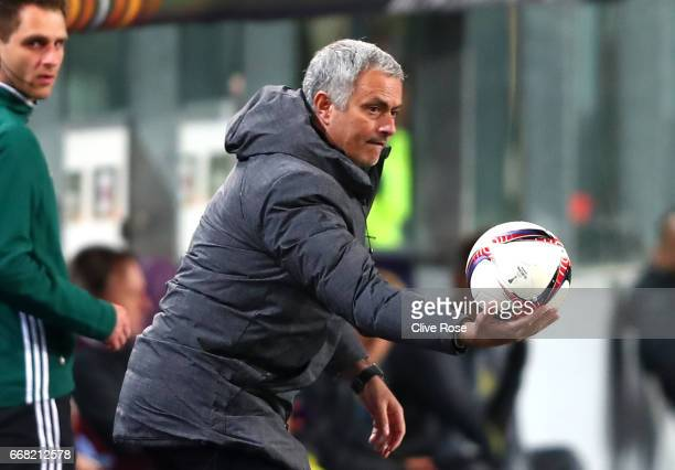 Jose Mourinho Manager of Manchester United holds the match ball during the UEFA Europa League quarter final first leg match between RSC Anderlecht...