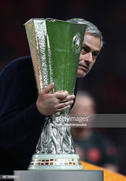Jose Mourinho Manager of Manchester United holds the trophy following victory in the UEFA Europa League Final between Ajax and Manchester United at...