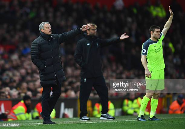 Jose Mourinho manager of Manchester United Jurgen Klopp manager of Liverpool and James Milner of Liverpool appeal during the Premier League match...