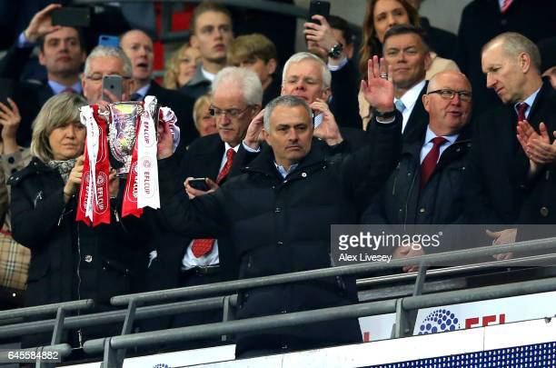 Jose Mourinho manager of Manchester United lifts the trophy in victory after during the EFL Cup Final between Manchester United and Southampton at...