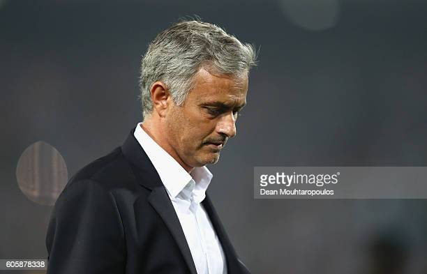 Jose Mourinho Manager of Manchester United looks dejected following his teams defeat in the UEFA Europa League Group A match between Feyenoord and...