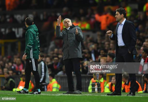 Jose Mourinho manager of Manchester United reacts as Rene Weiler head coach of RSC Anderlecht looks on during the UEFA Europa League quarter final...
