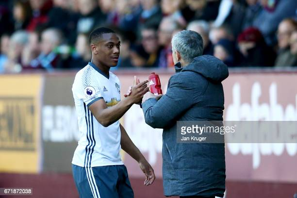 Jose Mourinho manager of Manchester United shakes hands with Anthony Martial of Manchester United as he is substituted during the Premier League...