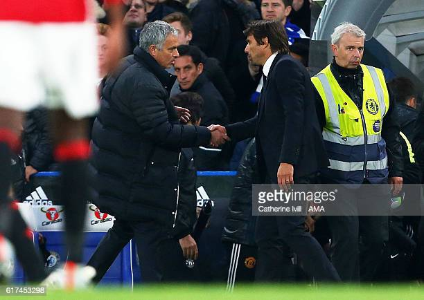 Jose Mourinho Manager of Manchester United shakes hands with Antonio Conte manager of Chelsea after the Premier League match between Chelsea and...