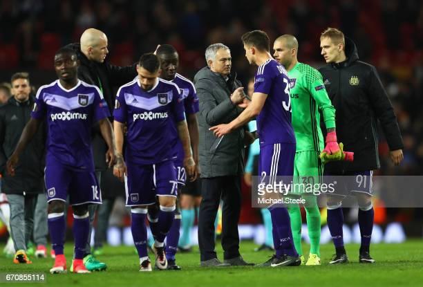 Jose Mourinho manager of Manchester United shakes hands with Leander Dendoncker of RSC Anderlecht after the UEFA Europa League quarter final second...