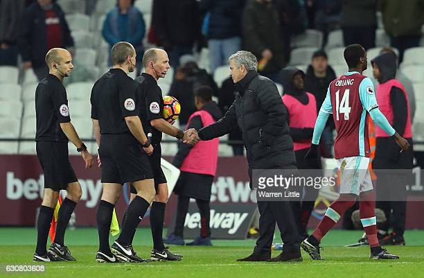 Jose Mourinho Manager of Manchester United shakes hands with referee Mike Dean after the Premier League match between West Ham United and Manchester...