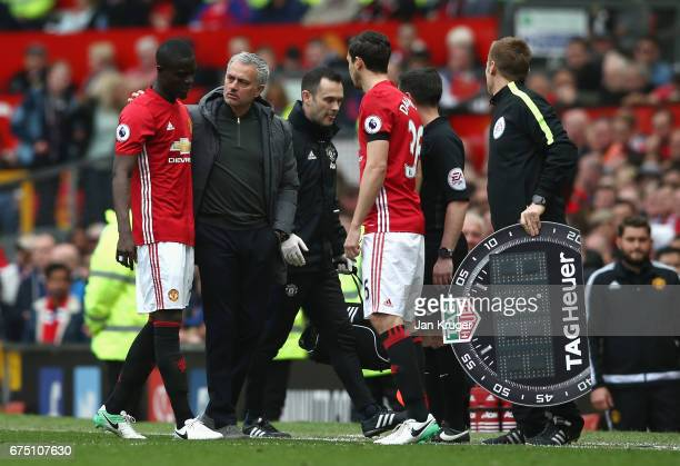 Jose Mourinho Manager of Manchester United speaks to Eric Bailly of Manchester United as he is forced off with a injury during the Premier League...