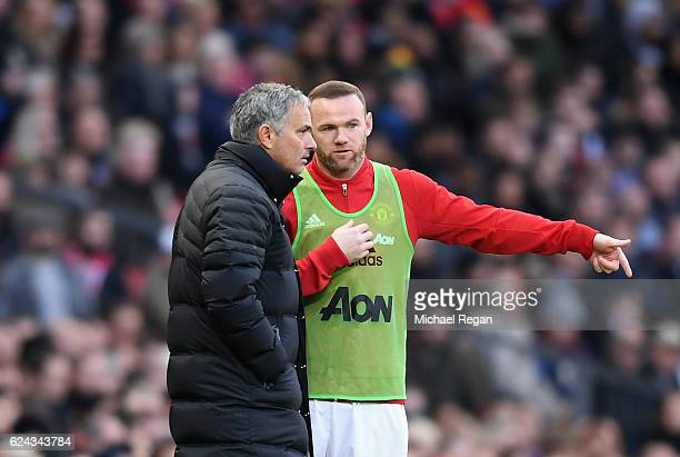 Jose Mourinho Manager of Manchester United speaks to Wayne Rooney of Manchester United during the Premier League match between Manchester United and...