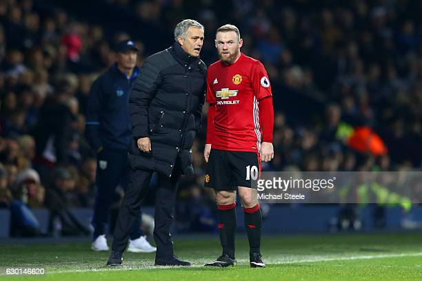 Jose Mourinho Manager of Manchester United speaks to Wayne Rooney of Manchester United during the Premier League match between West Bromwich Albion...