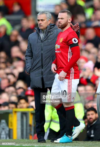 Jose Mourinho Manager of Manchester United speaks to Wayne Rooney of Manchester United before he comes on during the Premier League match between...