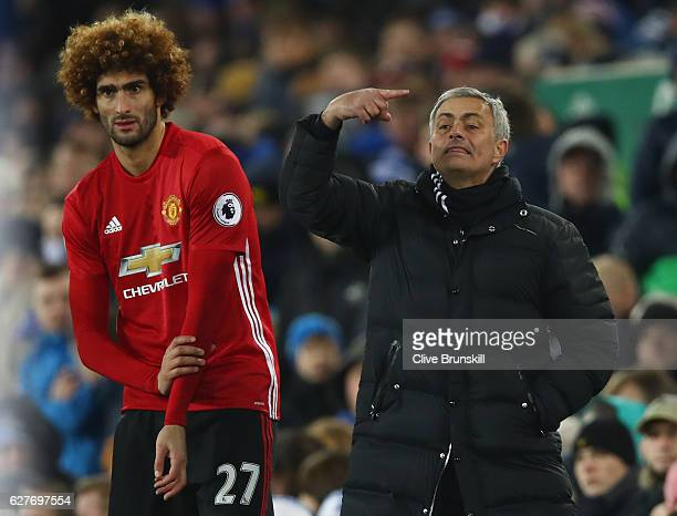 Jose Mourinho manager of Manchester United stands alongside his substitute Marouane Fellaini of Manchester United during the Premier League match...