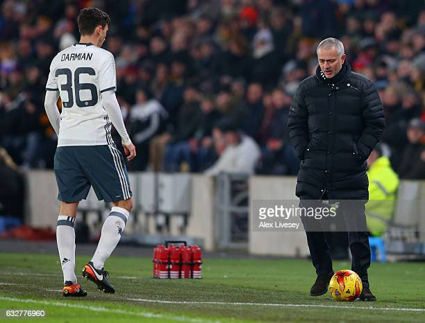 Jose Mourinho manager of Manchester United stops the ball for Matteo Darmian of Manchester United during the EFL Cup SemiFinal second leg match...
