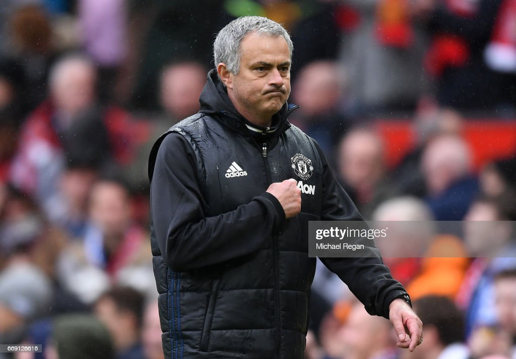 Jose Mourinho, Manager of Manchester United walks towards the tunnel after the Premier League match between Manchester United and Chelsea at Old Trafford on April 16, 2017 in Manchester, England.