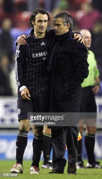 Jose Mourinho of Chelsea celebrates their win with Ricardo Carvalho after the Barclays Premiership match between Wigan Athletic and Chelsea at The...