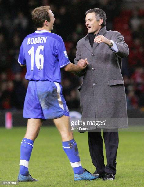 Jose Mourinho of Chelsea congratulates Arjen Robben at the end of the Carling Cup semifinal second leg between Manchester United and Chelsea at Old...