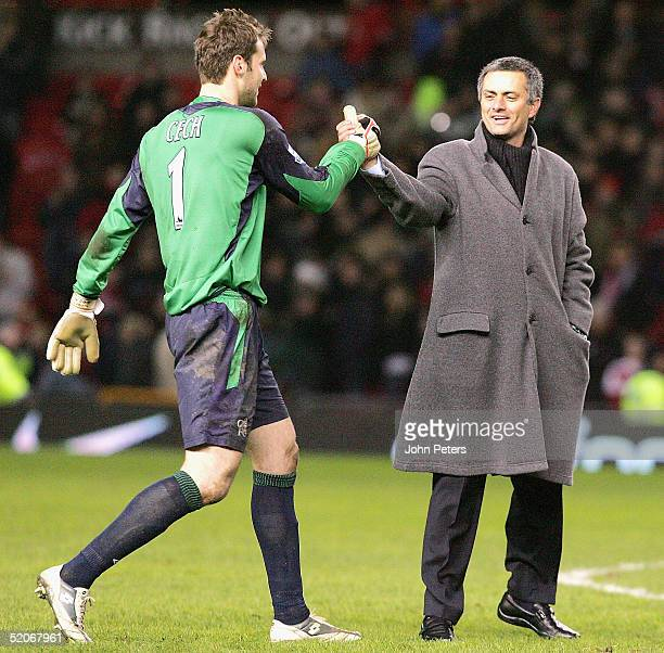 Jose Mourinho of Chelsea congratulates Petr Cech at the end of the Carling Cup semifinal second leg between Manchester United and Chelsea at Old...