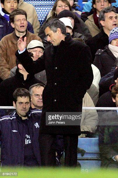Jose Mourinho of Chelsea reacts with dismay after appealing with the fourth official for more addedon time during the Carling Cup semifinal first leg...
