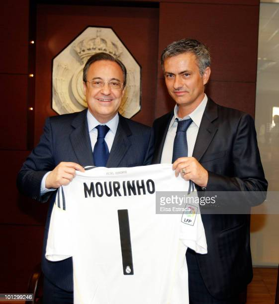 Jose Mourinho poses next to President of Real Madrid Florentino Perez after signing his contract to become the new head coach of Real Madrid coach at...