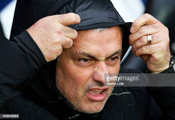 Jose Mourinho the Chelsea manager braves the elements during the Barclays Premier League match between Southampton and Chelsea at St Mary's Stadium...