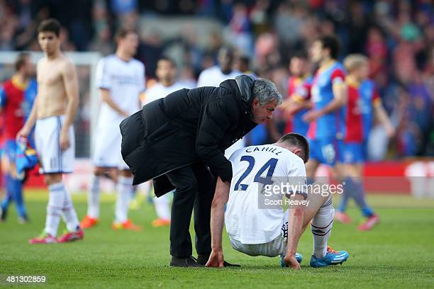 Jose Mourinho the Chelsea manager consoles the dejected Gary Cahill of Chelsea following heir team's 10 defeat during the Barclays Premier League...