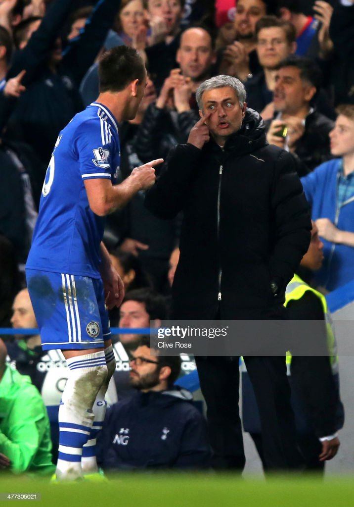 Jose Mourinho the Chelsea manager exchanges words with <a gi-track='captionPersonalityLinkClicked' href=/galleries/search?phrase=John+Terry&family=editorial&specificpeople=171535 ng-click='$event.stopPropagation()'>John Terry</a> the Chelsea captain during the Barclays Premier League match between Chelsea and Tottenham Hotspur at Stamford Bridge on March 8, 2014 in London, England.
