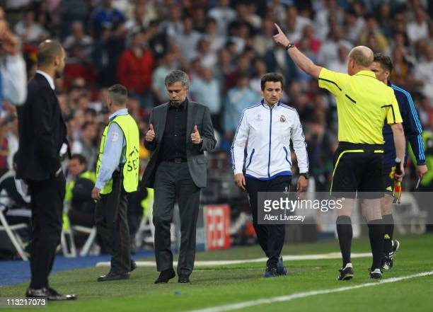 Jose Mourinho the coach of Real Madrid gives a thumbs up to the assistant referee as he is sent off to the stands during the UEFA Champions League...