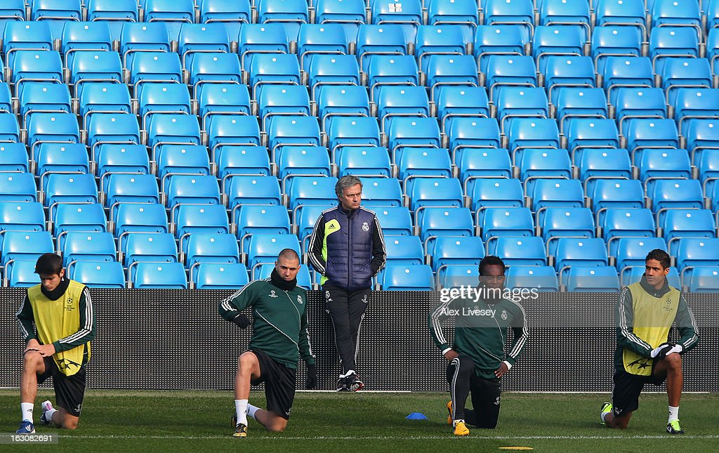 Jose Mourinho the coach of Real Madrid looks on as his players stretch during a training session at Etihad Stadium on March 4, 2013 in Manchester, England.