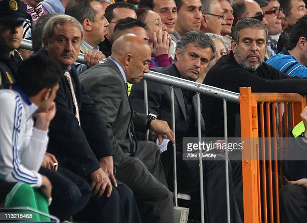 Jose Mourinho the coach of Real Madrid passes a note to his bench with instructions after being sent off to the stands during the UEFA Champions...