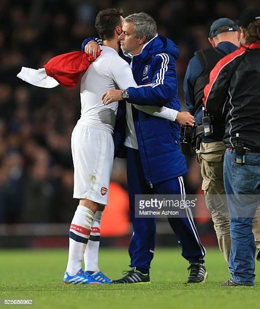 Jose Mourinho the head coach / manager of Chelsea hugs Mesut Ozil of Arsenal