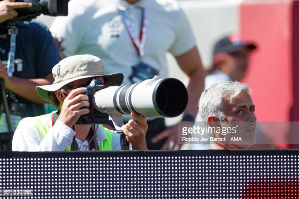 Jose Mourinho the head coach / manager of Manchester United sits in with the photographers to watch the penalties during the International Champions...