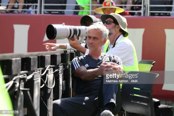 Jose Mourinho the head coach / manager of Manchester United sits with the photographers during the end of game penalty shootout during the...