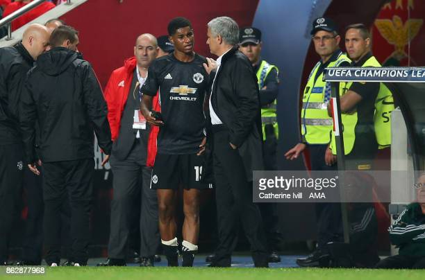 Jose Mourinho the head coach / manager of Manchester United talks to an injured Marcus Rashford of Manchester United as he leaves the pitch during...