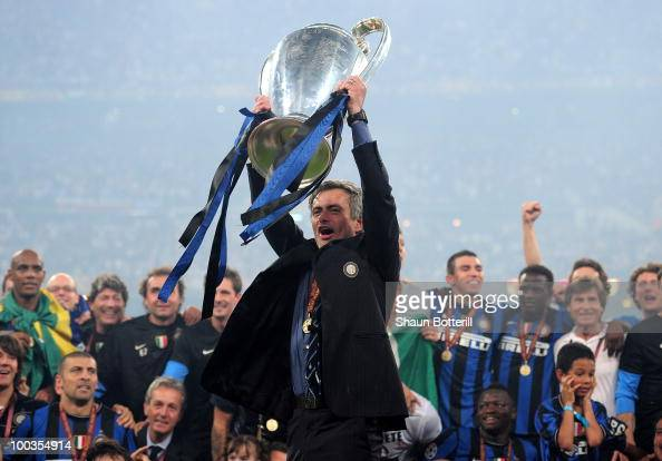 Jose Mourinho the Inter Milan coach holds the trophy aloft after winning the UEFA Champions League Final match between FC Bayern Muenchen and Inter...