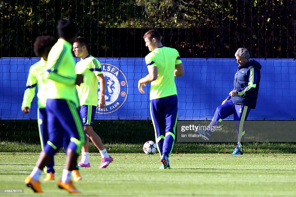 Jose Mourinho the manager of Chelsea kicks a ball during the Chelsea training session ahead of the UEFA Champions League Group F match against NK...