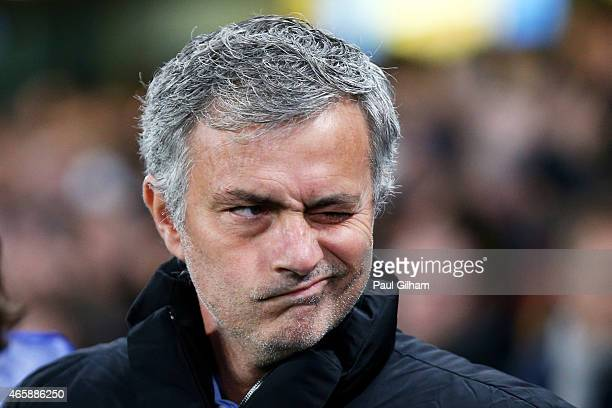 Jose Mourinho the manager of Chelsea winks prior to kickoff during the UEFA Champions League Round of 16 second leg match between Chelsea and Paris...