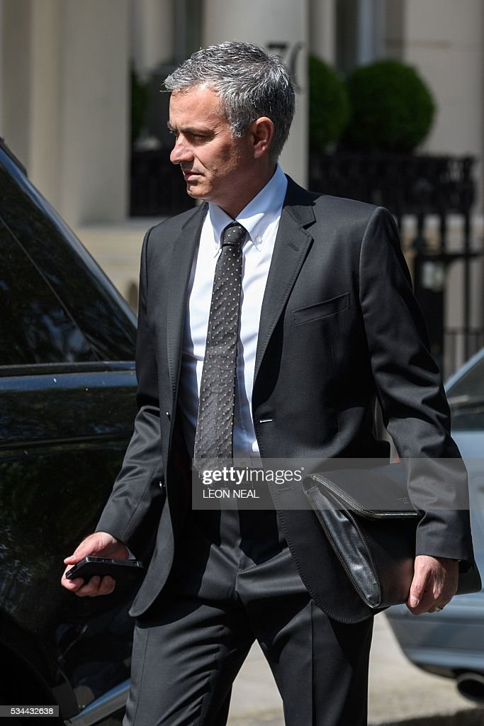 Jose Mourinho walks to a car before being driven away from his home in central London on May 26, 2016. The prospect of Jose Mourinho becoming Manchester United's next boss has unleashed hopes across Europe of a mega-spending spree by the English giants to get back into the elite. / AFP / LEON
