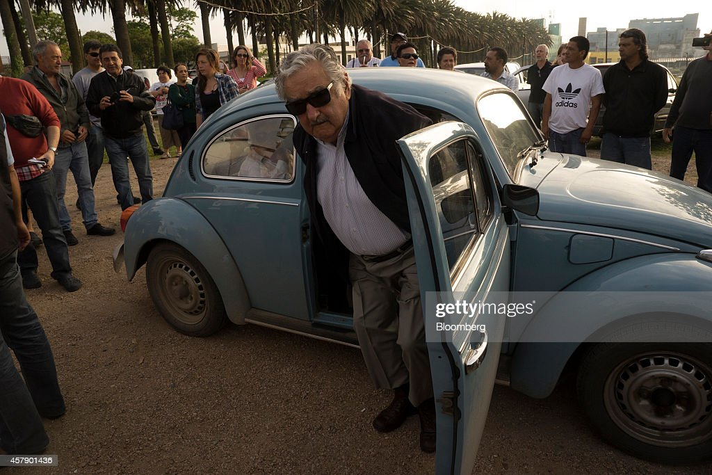 <a gi-track='captionPersonalityLinkClicked' href=/galleries/search?phrase=Jose+Mujica&family=editorial&specificpeople=637688 ng-click='$event.stopPropagation()'>Jose Mujica</a>, Uruguay's president, arrives at a polling station in his own car in Montevideo, Uruguay, on Sunday, Oct. 26, 2014. Polls show the vote will probably go to a second round on Nov. 30 between ruling Broad Front candidate Tabare Vazquez and the opposition National Party's Luis Lacalle Pou. Photographer: Mariana Greif Etchebehere/Bloomberg via Getty Images