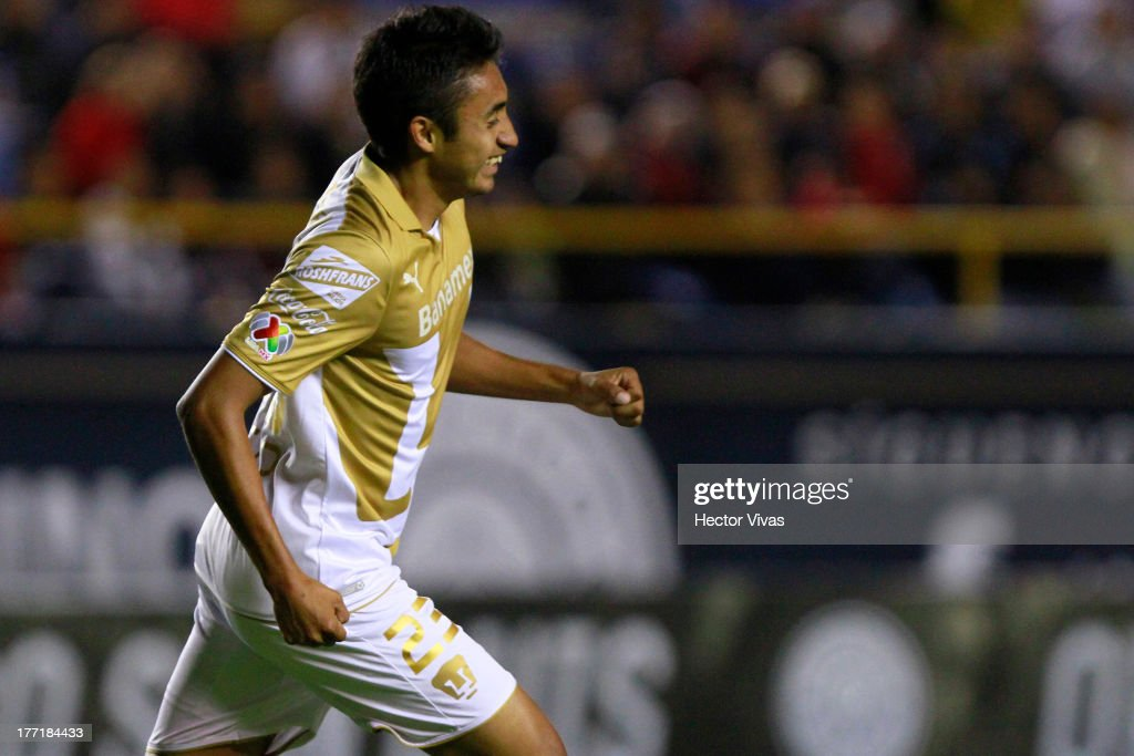 Jose Nieto of Pumas celebrates during a match between San Luis and Pumas as part of the Apertura 2013 Copa MX at Alfonso Lastras Stadium on August 21...