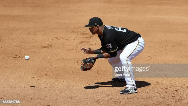 Jose Osuna of the Pittsburgh Pirates fields the ground ball during the fourth inning of a spring training game against the Baltimore Orioles on March...