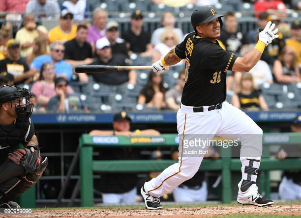 Jose Osuna of the Pittsburgh Pirates hits an RBI double to right field in the fifth inning during the game against the Arizona Diamondbacks at PNC...