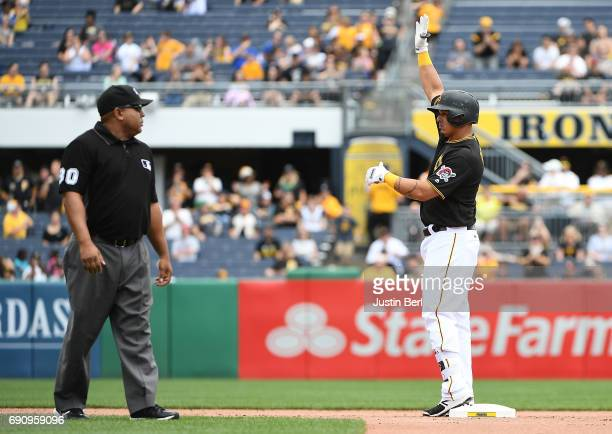 Jose Osuna of the Pittsburgh Pirates reacts after hitting an RBI double to right field in the fifth inning during the game against the Arizona...