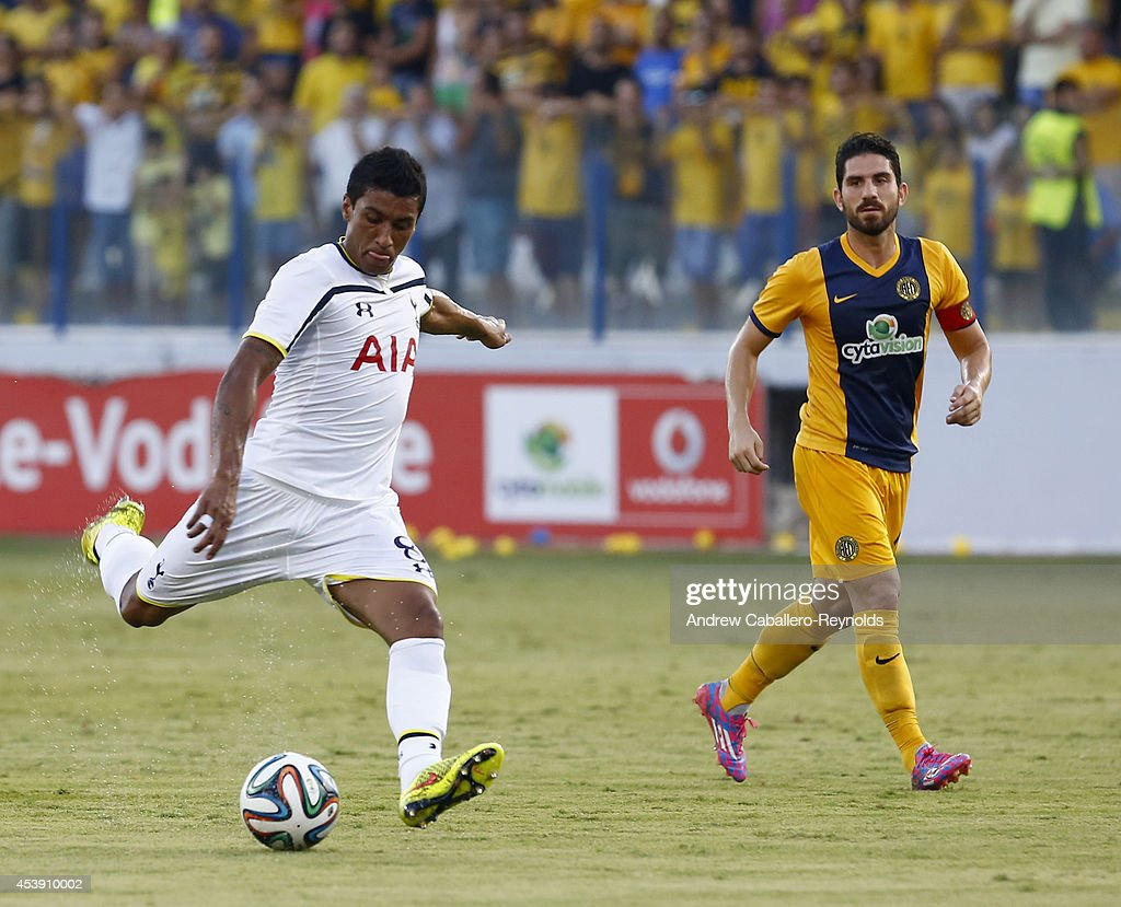 Jose Paulo Bezzera Jr (L) from Tottenham Hotspur fights for the ball with Marios Nikolaou from AEL Limassol FC during the AEL Limassol FC v Tottenham Hotspur - UEFA Europa League Qualifying Play-Off match on August 21, 2014 in Larnaca, Cyprus.