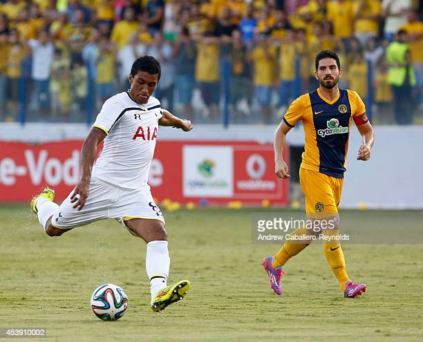 Jose Paulo Bezzera Jr from Tottenham Hotspur fights for the ball with Marios Nikolaou from AEL Limassol FC during the AEL Limassol FC v Tottenham...
