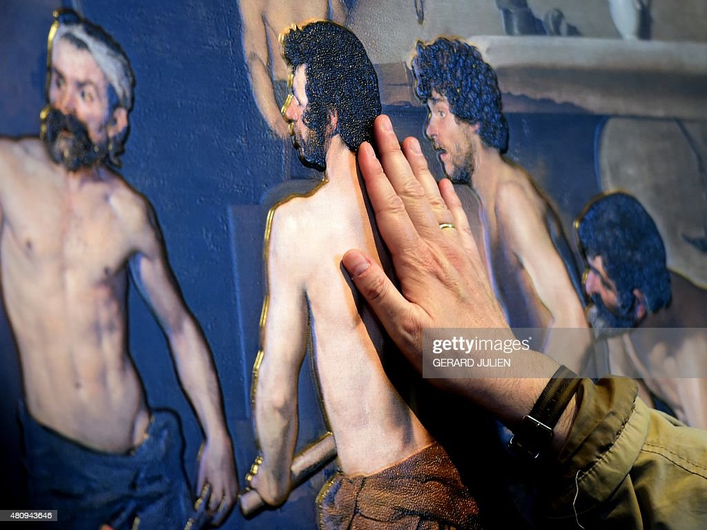 Jose Pedro Gonzalez a 56yearold blind visitor touches a painting using a relief painting technique that adds volume and texture a copy of 15th...