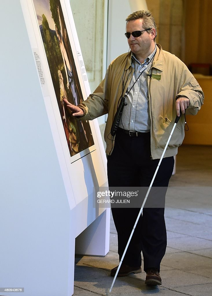 Jose Pedro Gonzalez a 56yearold blind visitor touches a painting using a relief painting technique that adds volume and texture a copy of 'Noli me...