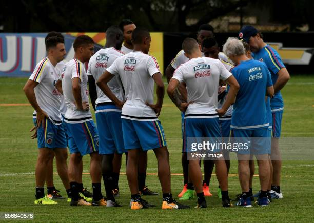 Jose Pekerman coach of Colombia gives instructions to his players during a training session at Autonoma del Caribe University Sports Center on...